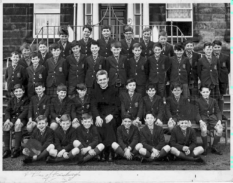Class  Photo P6 1964.JPG - Back Row:- Alex Moat, Peter Rogers, Cesidio Di Ciacca, Michael Stewart, Thomas Crawford?, Robert Rennie. Forth Row Left:- David Brand, Graham Laidlaw, Right:- Stuart Gunn, Andrew Borys? Middle Row:- Philip Anderson?, Thomas Conlon, Alan Bryson, Peter Callaghan?, James McGuire, Anthony Hetherington, David Gordon, Dennis Kelly, Rory Grany, ?. Second Row:- Paul DiRollo, Raymond Ross, Philip Contini, Robert Lawrie?, Br Carmody, Anrew Redpath, Donald Summerville, Charles Greig, Kevin Thomson? front Row:- Charles begbie, Francis Lloyd, Andrew Malone, Paul Valerio?, Paul Pelosie?, Martin Pia. names supplied by Andrew Malone.