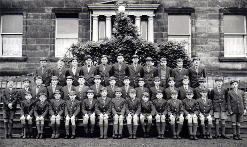 Class Photos Senior 1 1956.jpg - PHOTO PROBABLY IN 1956 OR 1957  -  1ST YEAR (SECONDARY) PUPILS IN PHOTO  (ALL ROWS FROM LEFT TO RIGHT) BACK ROW  Michael BLEAKLEY;  Tony KELLY;  Tony TAYLOR;  Brian VELZEAN;  Keith SINCLAIR;  Max GUNN; Michael SHIELS;  Eddy EPRILE;  Brian HUNT;  Teddy CZERCIECK;  John LYNCH. MIDDLE ROW ???;  Tony WARD;   Robert ROSS;   John MORAN;  Tommy MCILROY;  James WALSHE;  Dennis FLYNN;  Eddy JONES;   Jimmy COLVIN;   Michael LEWIS;   Kenneth GILHOOLY;  Rupert BURRINGTON;  William MORRISON;  Peter WHISTON;  Donald Shaw;  Nigel SMITH. FRONT ROW Roddy ZENTIL;  Brian ECKERSLEY;  ???;  Eugene GALBRAITH;  John BACIGALUPO;   Paul GUNN;  Jo FLAHERTY;  Jimmy MULDOON;  Peter YEO;  Ronnie ROWLEY;  Hugh WRAY;  Michael REYNOLDS;  Neil MACKENZIE. Names supplied by Tony Ward, (if you see any errors please let us know)