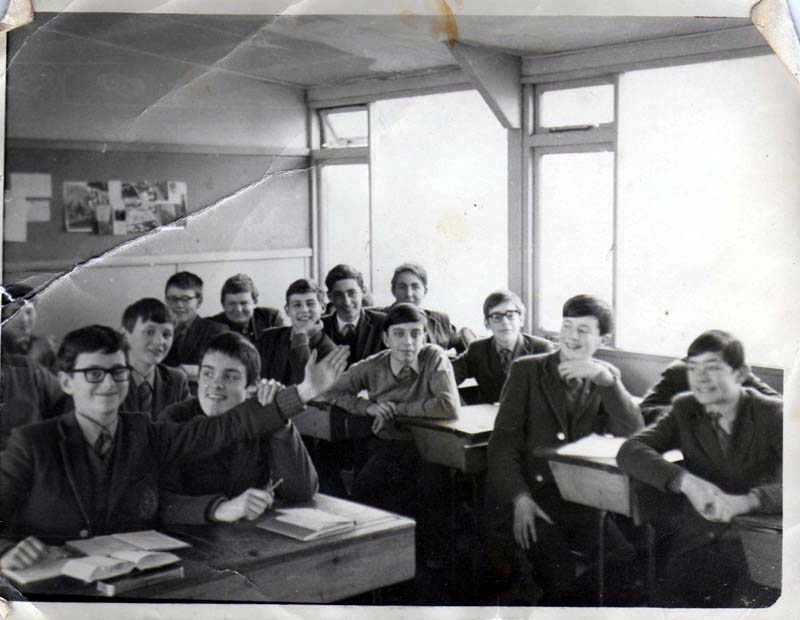Class c1968.jpg - This photo was taken and developed by Brother Engel. Gerry McBride (who supplied this photo) remembers a number of the names of his fellow pupils and he lists them below from left to right. At the back George Dudgeon at the front Mike? Ross, behind him O'Dwyer behind him at the back Gerry McCabe and Norman Stone. In front them Philip Conti, Gerry McBride Can't remember who is on my left. In front of me Andrew Reidpath. Can't remember names to his left or in front. Lastly Martin Pia. He think this was 68/69Richard Acomb contacted us to say - Its Raymond Ross at the front of class whose left arm is extended under my throat! My face was not obstructed but I do look a little disconcerted!  Behind me is Michael O'Dwyer. Gerry McCabe and Norman Stone at the very back. Philip Contini and Francis Pritchard in front of them. Is that Gerry McBride between Philip Contini and Francis Pritchard? Andrew Redpath to Gerry's front and it is David Gordon to the Andrew Redpath's left hand side. In front of Andrew Redpath is Chris Rogers who is behind Martin Pia.