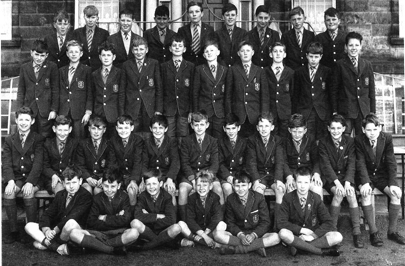 Class of 67.jpg - Back Row:- Chris Kerr, Raymond Joslin, Frank Dougan, Eion Coulthard, John McDonald, Tom Rooney, Freddy D'Agostino, Alan McMillan, Neil McLeod. Third Row:- Wyndham (Donald) Smith, Charles Packham, Ian Dunlop, Adam Jerzac, Martin Black, Cormack McGee, Alan Aston, John Strathie, Tony Docherty, Rob McLaren. Second Row:- Gery McEneny, Anrew Lindsay, Michael Nugent, Andrew Conlan, David Pia, Len Oliver, Leo Docherty, Tom Alexander, Brian Quigley, Joe Capaldi, Jack Kerr. Front Row:- Malcolm Pettigrew, Nicolas Conacher (Now Fr Giles), John Morrison, Willie Rowbottom, Michael Sommerville, John (Ozzy) Horner.