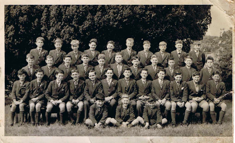 "Class photo 1960-61.jpg - Photo supplied by Stephen Z Koral, he didn't know the exact year this was taken but he said ""as I look about 13/14 assume c. 1960/1961"". Names from left to right – Sorry if wrong or mis-spelt! Denis O'Keefe, Tommy Kyle, Henry McLauchlan, Sandy Smith, Willie Craven, Peter Innes, Paul Cassidy, Alan Cunningham, Jozef Nigielski ?, ?, Alan Murray, Chris Pope, ?, Malcolm Wyllie, Mike Gallo, ?, ?, Anthony Vandenberg, Brian Hunter, Fred Campbell ?, Mike Donahue, Francis ?  If you can fill in the names of the ? please let us know."