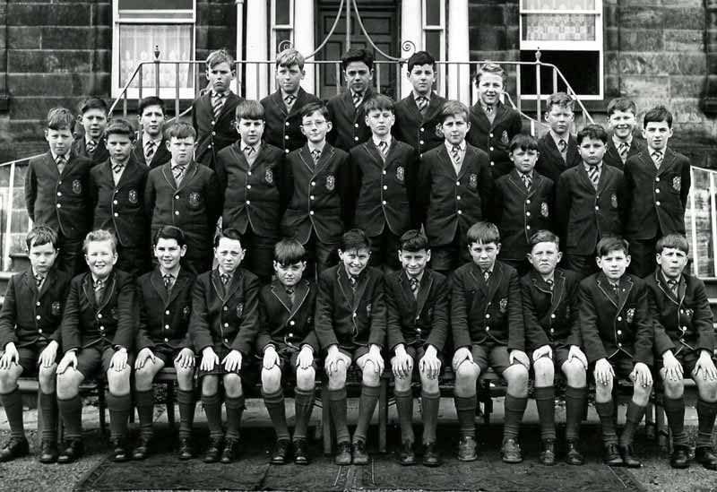 Class-Photo-1962.jpg - Back Row - Andrew Edie, Charlie Kerr, Peter DiRollo, Gregory Dickson, Stephen Turnbull.  Third row left - Charlie Ross, Maurice Dougan, Right - ?, Gerald Stone.  Second row - Mike McEwan, Gordon Flavel, ?, Adrain L'Estrange, ? Barry Smith, ?, Ricky Czarnota, John Macari, Michael Gaffney. Front row - Michael Peterson, Nicky Brotchie, Paul Mulhearn, ?, Richard Acomb, ?, Roman Miedzybrodzki, Mike Afek, Kevin Tierney, Mike Casey, Paul Coppola.