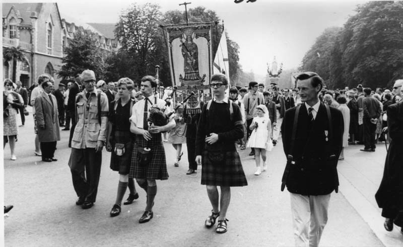 Lourdes 1.jpg - At the Lac Du Lourdes  In kilt and glasses Sandy Gordon, at the back looking away, David pia and in the front Tom Barry.