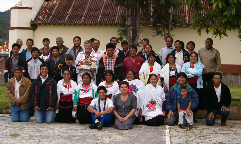 Huixtan cd Felipes qtn 053.jpg - Pictured is Father Henry McLauglin with some of his congregation in Mexico.