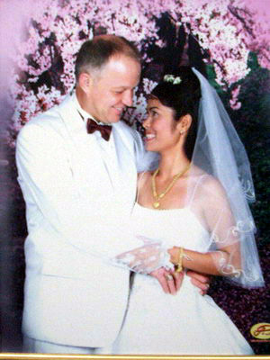 Trad uk wedding photo.jpg - Charles Law with his new wife.  Charles now lives in Thailand.