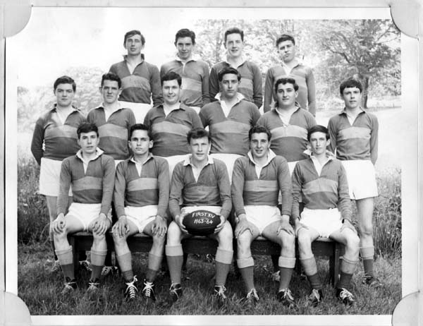 FirstXV-63-64.jpg - Fist XV 1963-64 Adrian McDonald,Ken O'Hara,Willie Parry, Lindsay WilsonJohn Cregan, Henry McLaughlin, Joe Tapper,Hubert Ross, John Bacigalupo,?Peter Slepokura, Ian Somerville,John Perrins(capt), Roddy Zentil,John Barry
