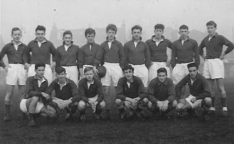 Rugby Team 1st XV 1959-60.jpg - Rugby Team 1st 1959-60. Before or after playing Holy Cross where they won 17-0 at home and 17-3 away.Back- J Hunter, P Martin, J Murdoch, P Nicol, J Regan, E Archibald, R Macari, J Hunt, M Sexton. Front- D Lanbery, D ANderson, J Clarke, L Cassisdy, E Jones, J Broadley.