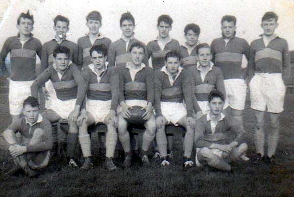 Scotus First XV 1960-1.jpg - Scotus XV 1960 John Lynch, Joe Flaherty,Tony Kelly, Chris Barlow, John Kelly, Ronnie Rowley, ?, Leo Stone Tony Thain, Laurie Cassidy,Mike Sexton,Eddie Jones, John C.Hunter,John Perrins, Roddy Zentil Photo of the team 60/61. We didn't win many matches that year as most of the team came from the 4th  form, so we usually had a weight disadvantage. (Notes from Mike Sexton)  The middle row were mostly 6th form (perhaps an odd one from 5th)   The photo was taken right at the end of the season, hence my position as  Acting Captain. Tich Clarke was the Team Captain but missed the last couple of matches through a cartilage injury.